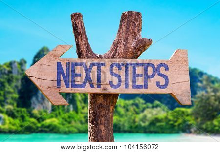 Next Steps arrow with beach background