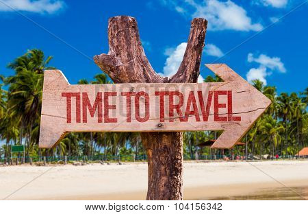 Time to Travel arrow with beach background