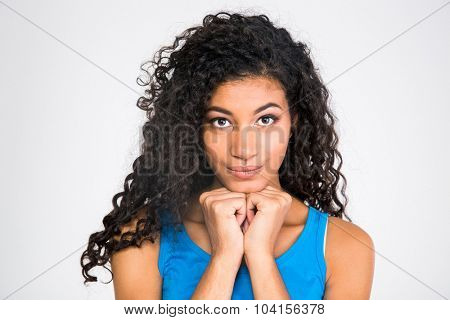 Portrait of a happy cute afro american woman looking at camera isolated on a white background