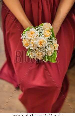 bouquet in the hands of the bridesmaid.