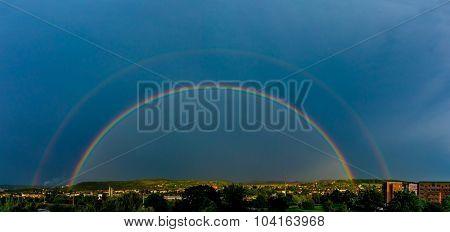 Panorama of a big summer rainbow