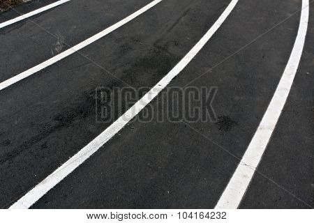 Running Asphalt Track With White Painted Lines.