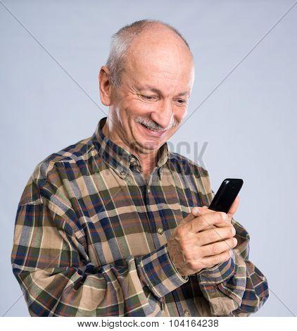 Smiling Senior Man In Shirt Talking On The Mobile Phone