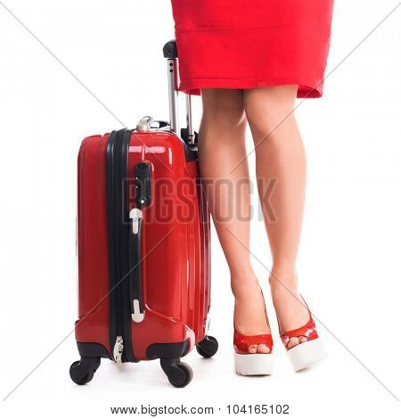 red suitcase and legs of girl with red dress and heels