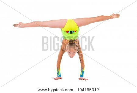 little gymnast standing on hands isolated on white background