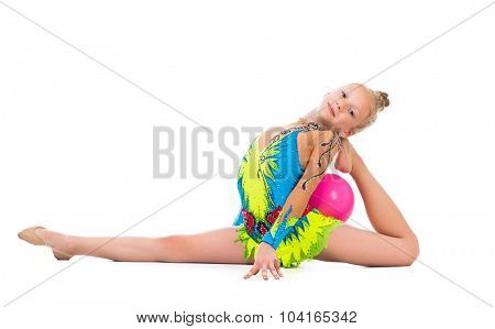 little gymnast doing an exercise with ball isolated on white background