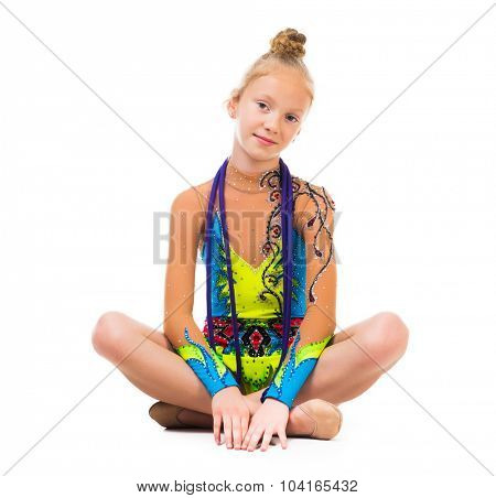 little gymnast sitting on the floor with skipping rope isolated on white background