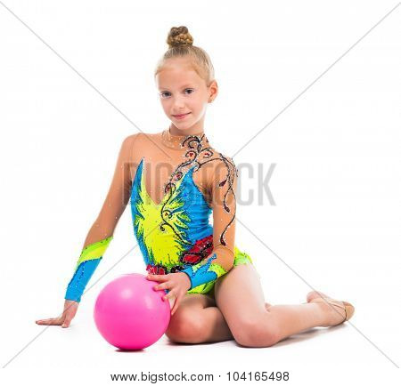 little gymnast sitting on the floor with ball isolated on white background