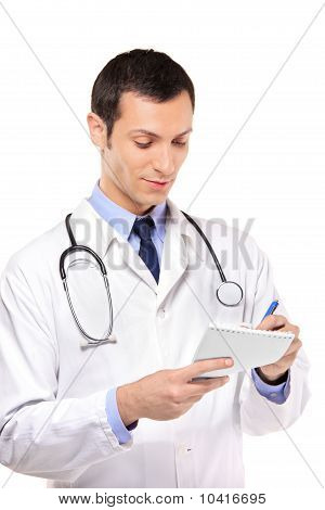 View Of A Young Medical Doctor Writing Down
