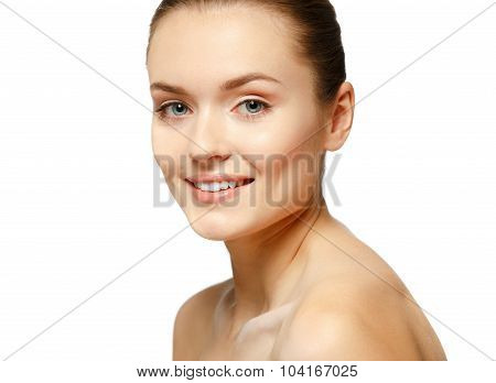 Portrait Of Beautiful Young Woman With Clean Face. High Key Shot