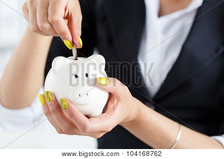 Female Hand Putting Pin Money Coins