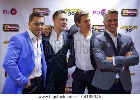 MOSCOW, RUSSIA - NOVEMBER 15, 2014: A group X-MISSION poses at a party Diskach 90th in a club Space Moscow. Group exists since 1997