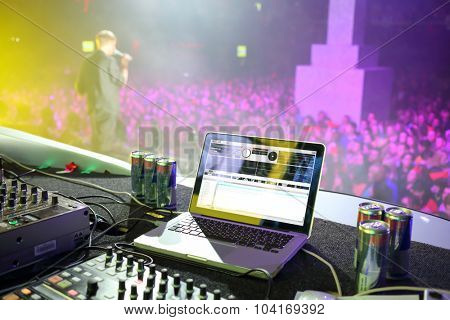 MOSCOW, RUSSIA - NOVEMBER 15, 2014: Laptop and DJ bar on the background of performance of the singer in nightclub Space Moscow at a party Diskach 90th