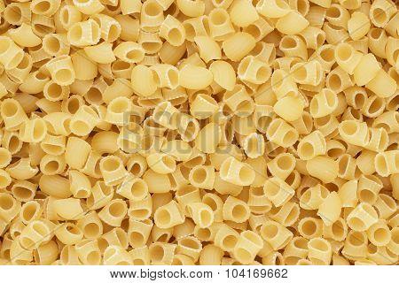 dry uncooked rigatoni pasta texture background