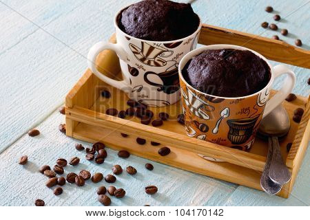 Quick Chocolate Coffee Cake In A Cup On A Wooden Table