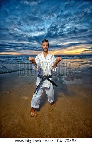 black belt karate mastar at sunset