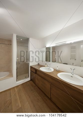 interior of new apartment, domestic bathroom with wooden cabinet
