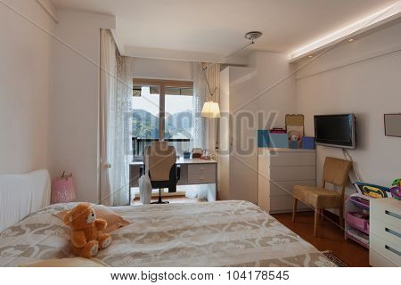 Interior of house, children room with double bed