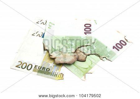Burnt Euro Banknotes On White