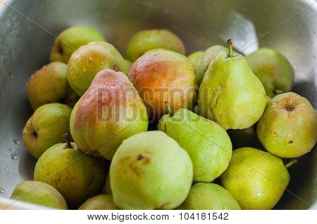 Fruit background. Fresh organic pears on old wood. Pear autumn harvest. Selective focus