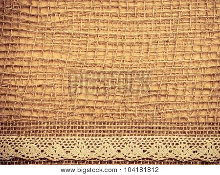 Lace Frame On Burlap Cloth Background