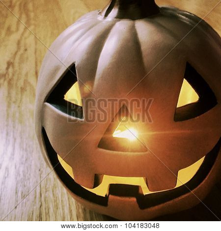 Halloween Jack o lantern with light flare - Instagram filtered