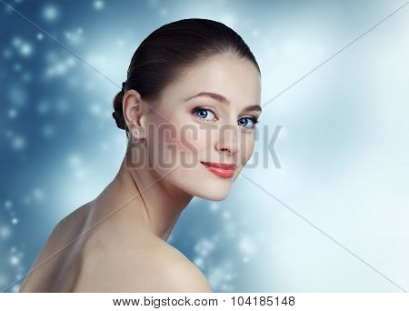 Portrait Of A Beautiful Young Girl Model With Clean Skin And Blue Eyes