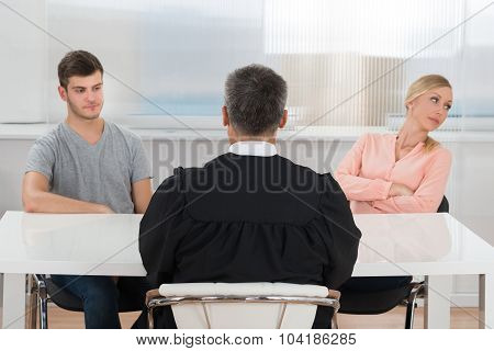 Judge In Front Of A Unhappy Couple