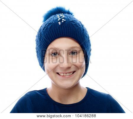 Portrait of girl wearing a winter cap smiling