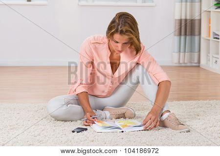Woman Writing Note In Diary