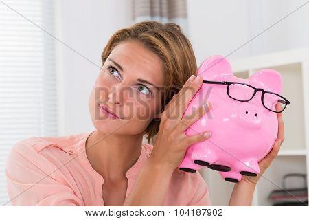 Woman Shaking Piggybank