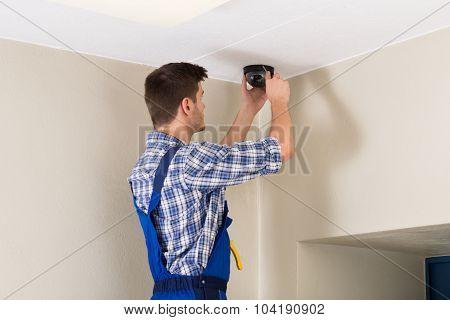 Technician Fitting Cctv Camera