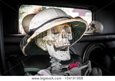 Laughing Skeleton in a Car