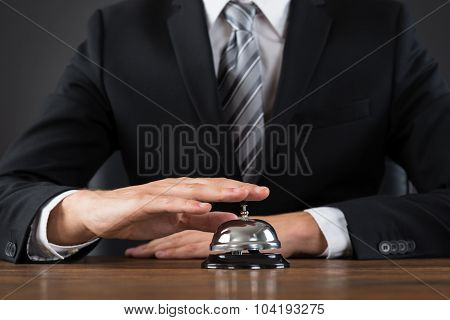 Businessperson Using Service Bell