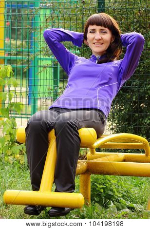 Woman Sitting On Bench And Doing Crunches, Healthy Lifestyle