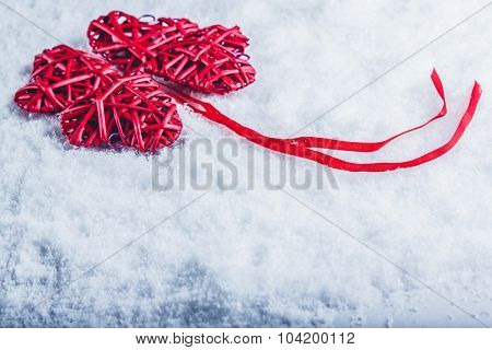 beautiful romantic vintage red hearts together in clover shape on a white snow background. Love and St. Valentines Day concept.