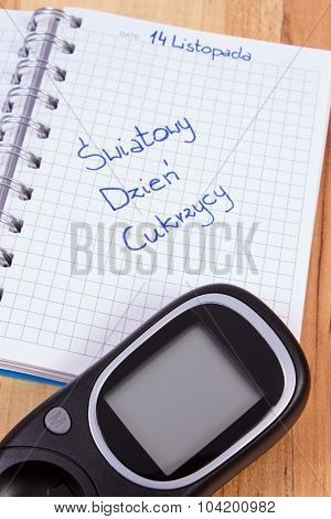 Glucometer And Polish Inscription World Diabetes Day In Notebook