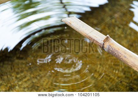 Bamboo fountain with water wave