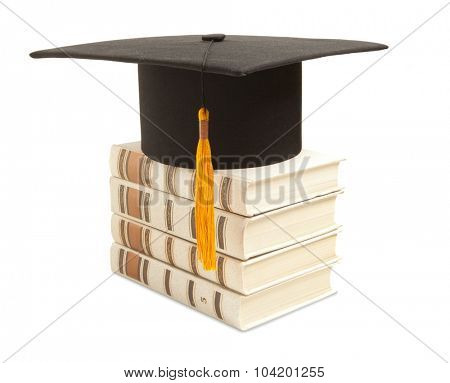 Mortarboard and book, isolated on white