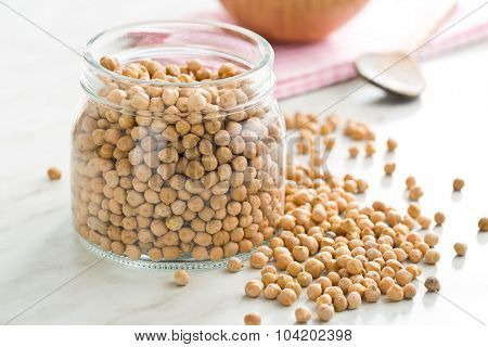 uncooked chickpeas in a jar