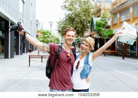Young couple in city posing for a photo