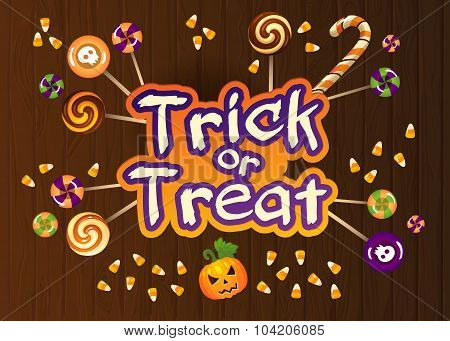 Happy Halloween Trick Or Treat Greeting Card With Sweets On Old Web Wood Background