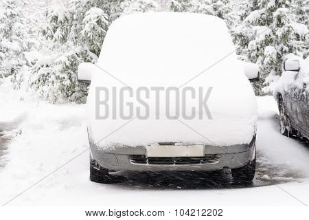The Car Under A Layer Of Snow