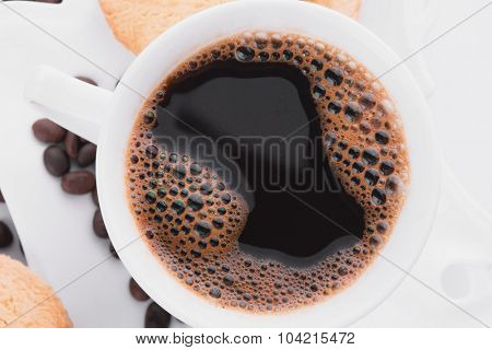Hot fresh coffee with cookies and coffee beans