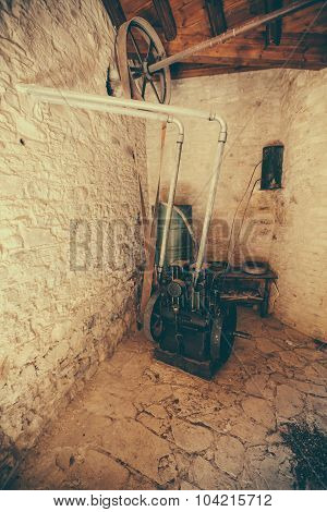 Engine in old factory for the production of olive oil