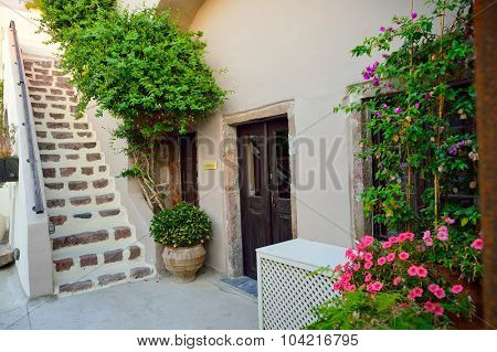 SANTORINI, GREECE - AUGUST 07, 2015: house courtyard on Santorini island. Santorini, classically Thera, and officially Thira, is an island in the southern Aegean Sea