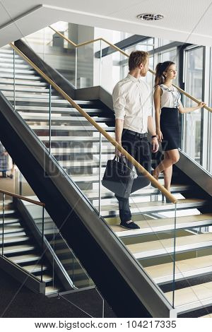 Businessman And Businesswoman Walking And Taking Stairs