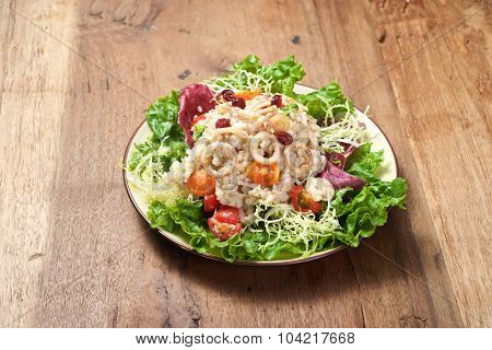 Plate Of Rice Salad On Wooden Table