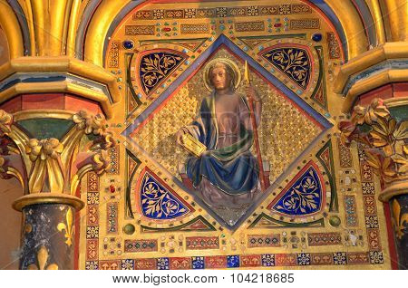 PARIS,  FRANCE - SEPTEMBER 8,  2014: Paris - Interiors of the Sainte-Chapelle (Holy Chapel). The Sainte-Chapelle is a royal medieval Gothic chapel in Paris and one of the most famous monuments of the city . Medallion set with fake gems representing the ap