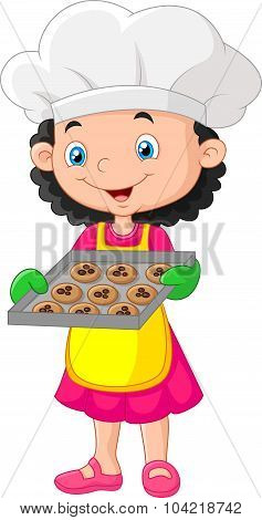 Little girl holding baking tray with baking ready to eat